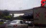 ماجرای خودکشی یک تهرانی روی پل همت +عکس