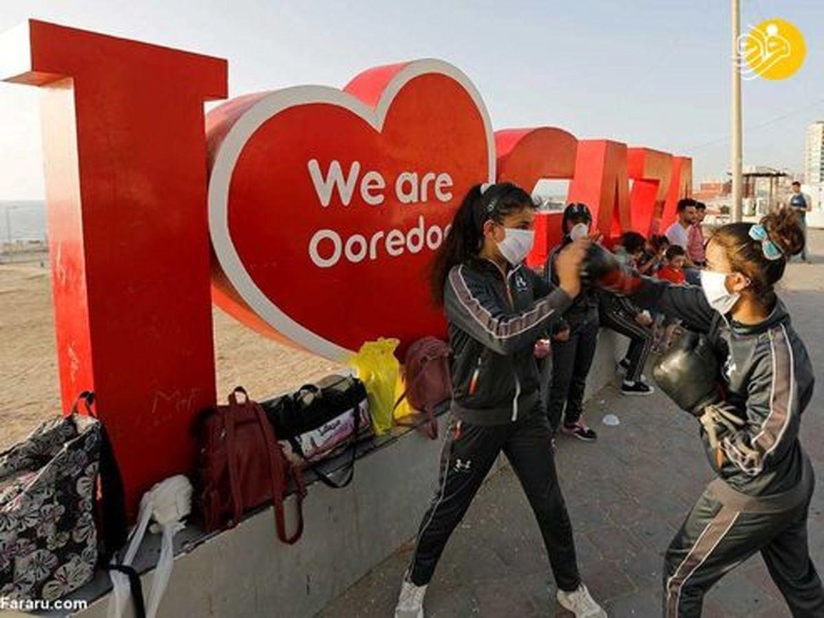 تصاویر: تمرین دختران بوکسور در خیابان